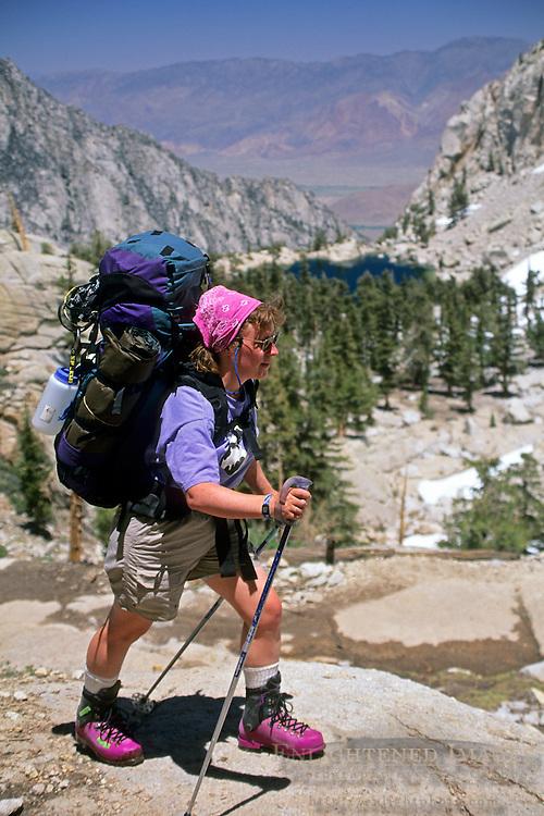 Female backpacker on the Mount Whitney Trail, Inyo National Forest, Eastern Sierra, California