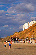 Israel, Natanya, the beach front Mature couple holding hands