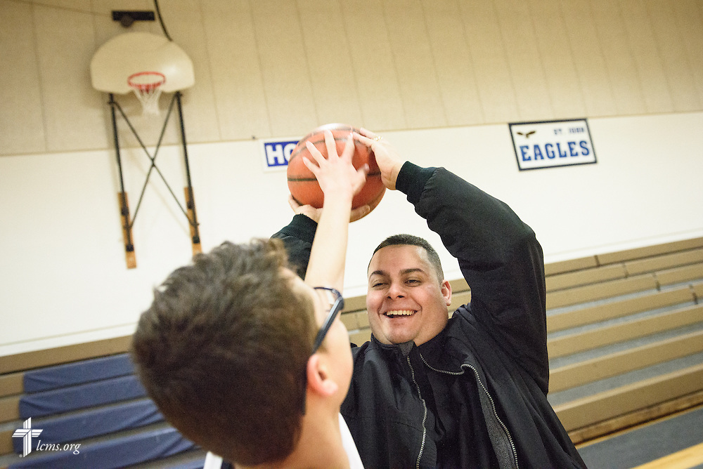 Vicar David Blas, missionary-at-large at LCMS Sheboygan County Hispanic Outreach and St. John's Lutheran Church of Plymouth, Wis., joins in a small pickup game with his son David following a scheduled game between schools on Thursday, Jan. 28, 2016. LCMS Communications/Erik M. Lunsford