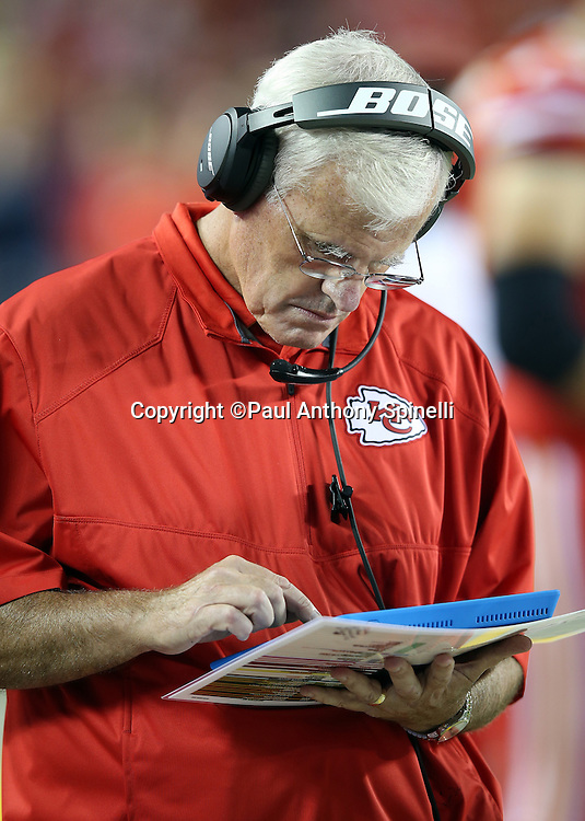 Kansas City Chiefs defensive coordinator Bob Sutton checks out his tablet during the NFL week 4 regular season football game against the New England Patriots on Monday, September 29, 2014 in Kansas City, Mo. The Chiefs won the game 41-14. ©Paul Anthony Spinelli