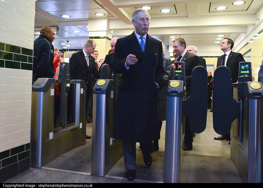 © Licensed to London News Pictures. 30/01/2013. London, UK Their Royal Highnesses enter Farringdon Station through a ticket barrier. HRH The Prince of Wales and HRH The Duchess of Cornwall visit Farringdon Station in London today 30th January 2013. They were carrying out engagements to celebrate London Underground's 150th anniversary.]. Photo credit : Stephen Simpson/LNP