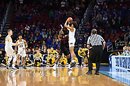 Mar 17, 2018; Wichita, KS, USA; Michigan Wolverines guard Jordan Poole (2) celebrates with his teammates including Moritz Wagner (13) after making the game-winning three point shot to defeat the Houston Cougars in the second round of the 2018 NCAA Tournament at INTRUST Bank Arena. Mandatory Credit: Peter G. Aiken-USA TODAY Sports