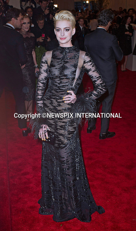 "ANNE HATHAWAY.attends the Costume Institute Gala at the Metropolitan Museum of Art, New York.The event is considered the Oscars of the Fashion world_06/05/2013.Mandatory credit photo:©Dias/NEWSPIX INTERNATIONAL..**ALL FEES PAYABLE TO: ""NEWSPIX INTERNATIONAL""**..PHOTO CREDIT MANDATORY!!: NEWSPIX INTERNATIONAL(Failure to credit will incur a surcharge of 100% of reproduction fees)..IMMEDIATE CONFIRMATION OF USAGE REQUIRED:.Newspix International, 31 Chinnery Hill, Bishop's Stortford, ENGLAND CM23 3PS.Tel:+441279 324672  ; Fax: +441279656877.Mobile:  0777568 1153.e-mail: info@newspixinternational.co.uk"