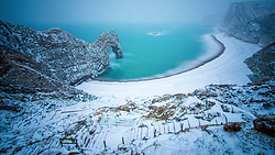 **2018 Pictures of the year by London News Pictures**<br /> © Licensed to London News Pictures. 01/03/2018. Lulworth, UK. Long exposure picture showing a snow covered Durdle Door on the Jurassic Coast near Lulworth in Dorset, England . Photo credit: Pete Scott/LNP