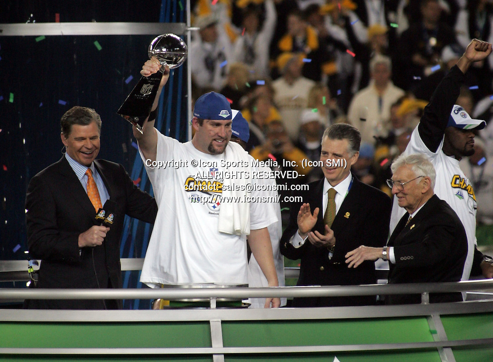 01 FEB 2009: Ben Roethlisberger of the Steelers shows the Vince Lombardi Trophy to the fans as Steelers owner Dan Rooney looks on after Super Bowl XLIII with the Arizona Cardinal versus the Pittsburgh Steelers at Raymond James Stadium in Tampa, Florida.  Head Coach Mike Tomlin is on far right of image waiving at fans.