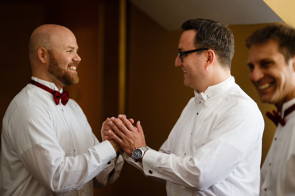 The groom gets ready for his wedding at Allerton Park Mansion in Monticello, Saturday, July 4, 2015. Photo by Justin Edmonds