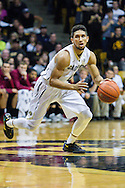 November 24th, 2013:  Colorado Buffaloes junior guard Askia Booker (0) brings the ball quickly down the court in the second half of the NCAA Basketball game between the Harvard Crimson and the University of Colorado Buffaloes at the Coors Events Center in Boulder, Colorado