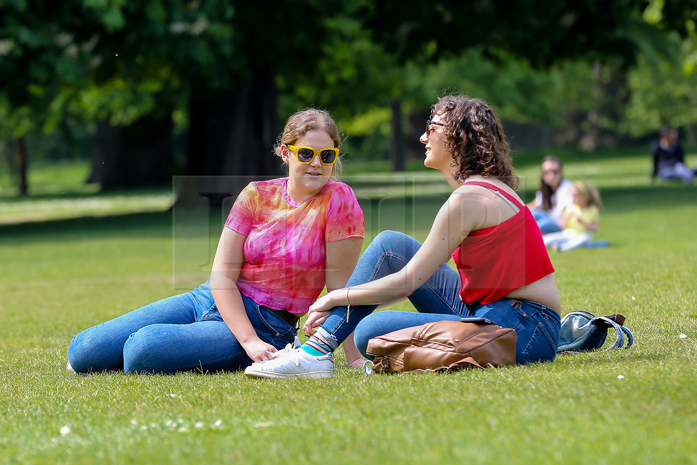 © Licensed to London News Pictures. 15/05/2019. London, UK. Couple women in London's Hyde Park enjoying the a warm and sunny weather in the capital. Temperatures are set to reach 20C in the capital and potentially higher in the some parts of the UK. Photo credit: Dinendra Haria/LNP