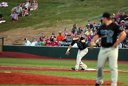 "1 June 2010: 1st baseman J.T. Restko pulls in a throw from 3rd for a tap out. The Windy City Thunderbolts are the opponents for the first home game in the history of the Normal Cornbelters in the new stadium coined the ""Corn Crib"" built on the campus of Heartland Community College in Normal Illinois."