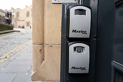 Key boxes for AirbnB guests to access door keys outside apartment building in Edinburgh Old Town, Scotland, UK