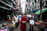 Monks walk the early morning streets of Yangon, Myanmar.