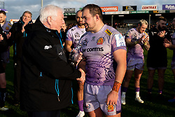 Tony Rowe OBE presents Ben Moon of Exeter Chiefs with his 250th Appearance Award after the final whistle of the match  - Mandatory by-line: Ryan Hiscott/JMP - 15/12/2019 - RUGBY - Sandy Park - Exeter, England - Exeter Chiefs v Sale Sharks - Heineken Champions Cup