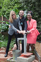 © Licensed to London News Pictures. 21/05/2012. London, England. Barbara Bach, Ringo Starr and Floella Benjamin pumping water at the Herbert Smith Garden for WaterAid. RHS Celsea Flower Show 2012 - Press Day. Photo credit: Bettina Strenske/LNP