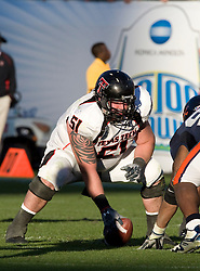 Texas Tech center Shawn Byrnes (51) prepares to snap the ball during the Gator Bowl.  The Texas Tech Red Raiders defeated the Virginia Cavaliers 31-28 in the 2008 Konica Menolta Gator Bowl held at the Jacksonville Municipal Stadium in Jacksonville, FL on January 1, 2008.