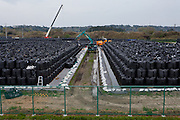 Topsoil in large vinyl bags is collected at a de-contamination centre near Nahara, Fukushima, Japan. Tuesday April 30th 2013 The Japanese government has decided to remove the topsoil and vegetation from the areas affected by radiation after the disaster at Fukushima Daichi nuclear plant on March 11th 2011