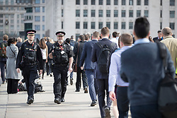 © Licensed to London News Pictures. 05/06/2017. London, UK. City of London police patrol London Bridge after it is opened for the first time following a terrorist attack on Saturday evening. Three men attacked members of the public after a white van rammed pedestrians on London Bridge. Ten people including the three suspected attackers were killed and 48 injured in the attack. Photo credit: Peter Macdiarmid/LNP