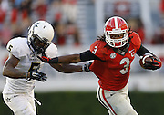 ATHENS, GA - OCTOBER 04:  Running back Todd Gurley #3 of the Georgia Bulldogs stiff arms cornerback Torren McGaster #5 of the Vanderbilt Commodores during a running playin the game at Sanford Stadium on October 4, 2014 in Athens, Georgia.  (Photo by Mike Zarrilli/Getty Images)