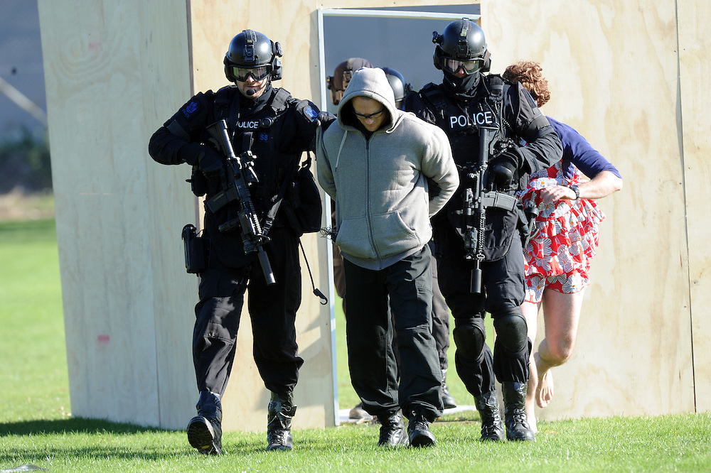 Police Special Tactics Group take part in an public display as part of the 50 year celebration of the AOS (Armed Offenders Squad) at the Royal Polce College, Porirua, New Zealand, Saturday, August 09, 2014. Credit:SNPA / Ross Setford