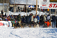 3/4/2007:  Willow, Alaska -  Race workers wave to Rookie Richard Hum of Talkeetna, AK as he starts the 35th Iditarod Sled Dog Race