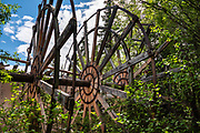 Paddlewheel graveyard, Yukon River Campground, Dawson City, Yukon, Canada. Explore the ruins of seven historic paddlewheel boats discarded in the woods along the banks of the Yukon River. Directions: On foot or auto, take the free George Black Ferry to West Dawson and the Top of the World Highway. Turn right into Yukon River campground and park at its northern end. Walk through the yellow gate, turn left, and walk downstream a few minutes to the Paddlewheel graveyard. Please respect this site, which is protected under the Yukon Historic Resources Act. Dawson City was the center of the Klondike Gold Rush (1896–99), after which population rapidly declined, in Yukon, Canada. Dawson City shrank further during World War II after the Alaska Highway bypassed it 300 miles (480 km) to the south using Whitehorse as a hub. In 1953, Whitehorse replaced Dawson City as Yukon Territory's capital. Dawson City's population dropped to 600–900 through the 1960s-1970s, but later increased as high gold prices made modern placer mining operations profitable and tourism was promoted. In Yukon, the Klondike Highway is marked as Yukon Highway 2 to Dawson City.