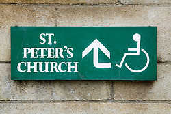 Disability access sign showing alternative entrance to church,