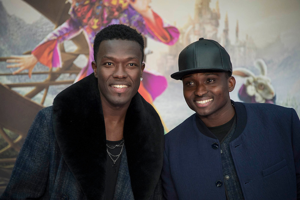 Reggie and Bollie from the X hfactor - Alice Through the Looking Glass premiere - a Walt Disney American fantasy adventure film directed by James Bobin, written by Linda Woolverton and produced by Tim Burton. It is based on Through the Looking-Glass by Lewis Carroll and is the sequel to the 2010 film Alice in Wonderland. The film stars Johnny Depp, Anne Hathaway, Mia Wasikowska, Rhys Ifans, Helena Bonham Carter, and Sacha Baron Cohen and features the voices of Alan Rickman, Stephen Fry, Michael Sheen, and Timothy Spall.