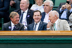 © Licensed to London News Pictures. 04/07/2019. London, UK. George Osborne (C) and Sir Peter Osborne (R) watch centre court tennis in the royal box on Day 4 of Wimbledon Tennis Championships 2019 held at the All England Lawn Tennis and Croquet Club. Photo credit: Ray Tang/LNP