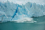Breaking of a building-sized chunk of ice, a process called calving, from the terminus of Perito Moreno Glacier.
