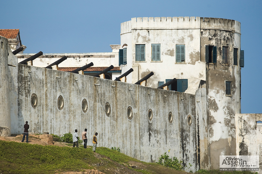 A group of young men hang out near Cape Coast castle, in Cape Coast, Ghana on Sunday September 7, 2008. The fort was used during the slave trade as one of several exit points for slaves leaving Africa for the New World.