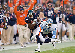 "Virginia wide receiver Jared Green (84) rushes past North Carolina safety Deunta Williams (27) for a first down as head coach Al Groh celebrates on the sidelines.  The Virginia Cavaliers defeated the #18 ranked North Carolina Tar Heels 16-13 in overtime in NCAA football at Scott Stadium on the Grounds of the University of Virginia in Charlottesville, VA on October 18, 2008.  The 113th meeting of the two teams, dubbed the ""Oldest Rivalry in the South"", saw UVA continue its streak of consecutive home victories over UNC -- the last time the Tar Heels won in Charlottesville was 1981."