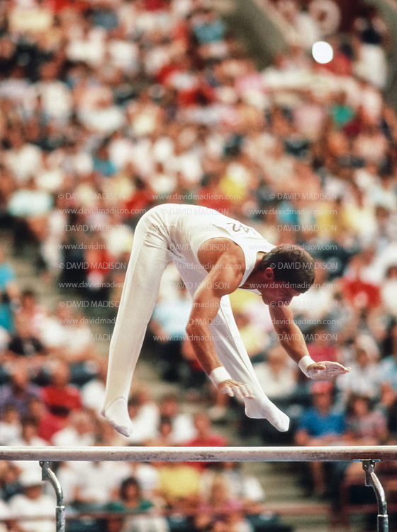 INDIANAPOLIS, IN - AUGUST 1987:  Tim Daggett of  the USA competes on the parallel bars during the 1987 Pan Am Games men's gymnastics competition in August 1987 at the Hoosier Dome in Indianapolis, Indiana.  (Photo by David Madison/Getty Images)