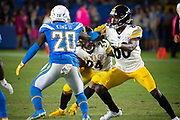 Pittsburgh Steelers running back Benny Snell (24) looks for a hole to run through behind teammate wide receiver Johnny Holton (80) during an NFL football game against the Los Angeles Chargers. The Steelers defeated the Chargers 24-17 on  Sunday, Oct. 13, 2019, in Carson, Calif. (Ed Ruvalcaba/Image of Sport)