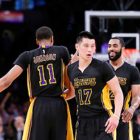 27 February 2015: Los Angeles Lakers forward Wesley Johnson (11) celebrates with Los Angeles Lakers guard Wayne Ellington (2) and Los Angeles Lakers guard Jeremy Lin (17) during the Los Angeles Lakers 101-93 victory over the Milwaukee Bucks, at the Staples Center, Los Angeles, California, USA.