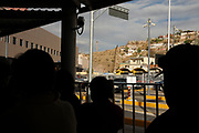 People wait in line in Nogales, Sonora, Mexico, to pass through U.S. customs inspections at the DeConcini Port of Entry to enter Nogales, Arizona, USA.