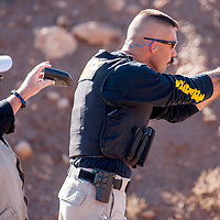 102613       Cable Hoover<br /> <br /> Cibola County Undersheriff Tony Mace, right, is timed by range officer Randy Ryan as he fires his pistol in the inter-agency shooting competition in Milan Saturday.
