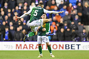 Mid air pass from 5 Mark Milligan to 14 Stevie Mallan during the Ladbrokes Scottish Premiership match between Hibernian and Rangers at Easter Road, Edinburgh, Scotland on 8 March 2019.