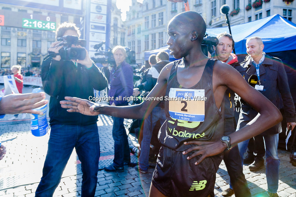 Brussels 2012 07 october. The Marathon of Brussels ended on the medieval central square (Grote Markt). In this picture the Kenian Winner     Joash Mutai. His compatriot Noah Kosgei  came in second for the second year running..The fastest Belgian was Jess Bertels who came in fifth.
