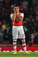 Alexis Sanchez of Arsenal holds his head in his hands during the Capital One Cup match at the Emirates Stadium, London<br /> Picture by David Horn/Focus Images Ltd +44 7545 970036<br /> 23/09/2014