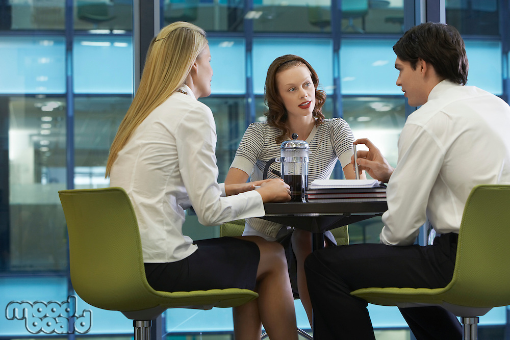 Three businesspeople taking a coffee break