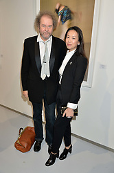 MIKE FIGGIS and ROSEY CHAN at a private view of Dancing Away featuring work by Mikhail Baryshnikov held at ContiniArtUK, 105 New Bond Street, London on 27th November 2014.