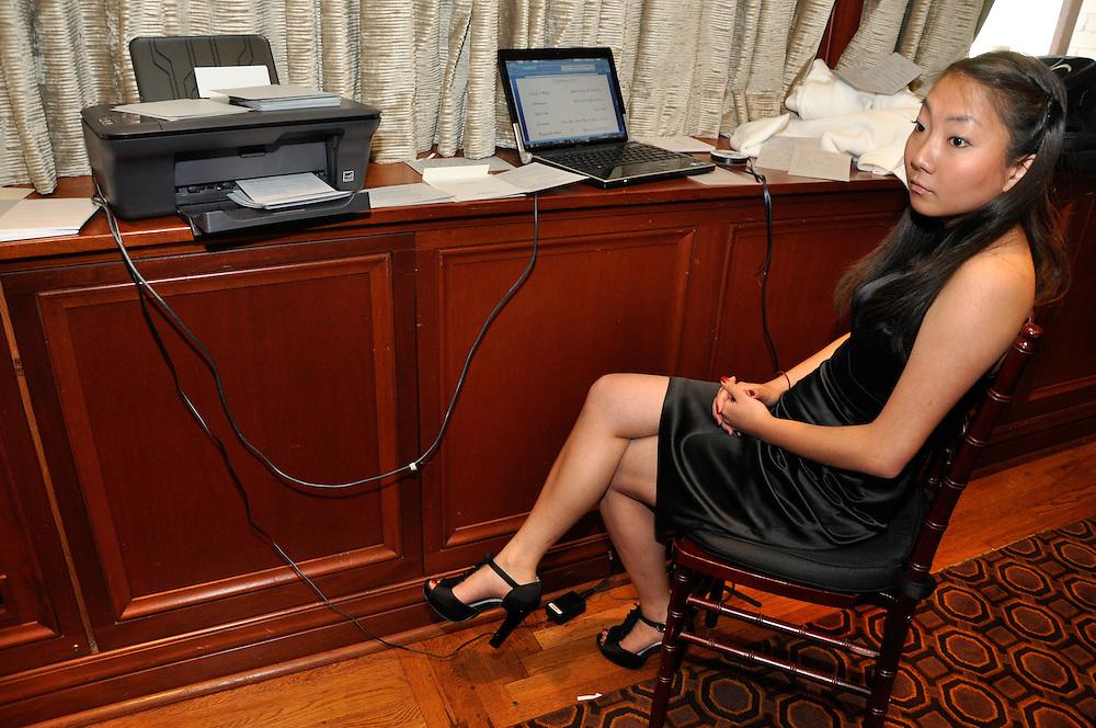 Uzoezi's bridesmaid oversees the operation of printing the ceremony programs, Merchant's Exchange, San Francisco