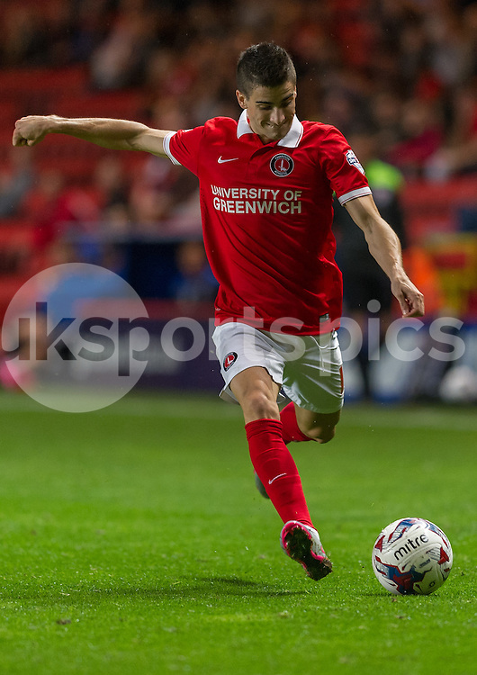 Cristian Ceballos of Charlton Athletic shoots during the Capital One Cup match between Charlton Athletic and Dagenham and Redbridge at The Valley, London, England on 11 August 2015. Photo by Vince  Mignott.