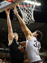 Vanderbilt's Josh Henderson (40) has his shot blocked by Texas A&M's Tyler Davis (34) during the second half of an NCAA college basketball game, Saturday, March 5, 2016, in College Station, Texas. Texas A&M won 76-67. (AP Photo/Sam Craft)