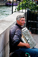 Paris, street accordian player