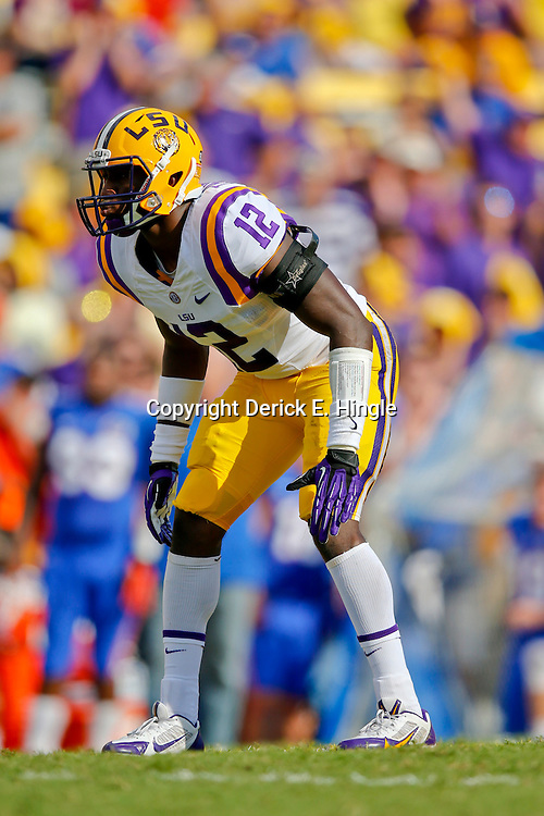 Oct 12, 2013; Baton Rouge, LA, USA; LSU Tigers safety Corey Thompson (12) against the Florida Gators during the first half of a game at Tiger Stadium. Mandatory Credit: Derick E. Hingle-USA TODAY Sports