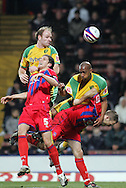 London - Tuesday, January 1st, 2008: Dion Dublin (R) is tussled by Crystal Palace defender Clint Hill as Gary Doherty (top) of Norwich City rises above Mark Hudson (L) to head the ball during the Coca Cola Championship match at Selhurst Park, London. (Pic by Mark Chapman/Focus Images)