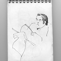 Sketchbook drawing of male figure reading