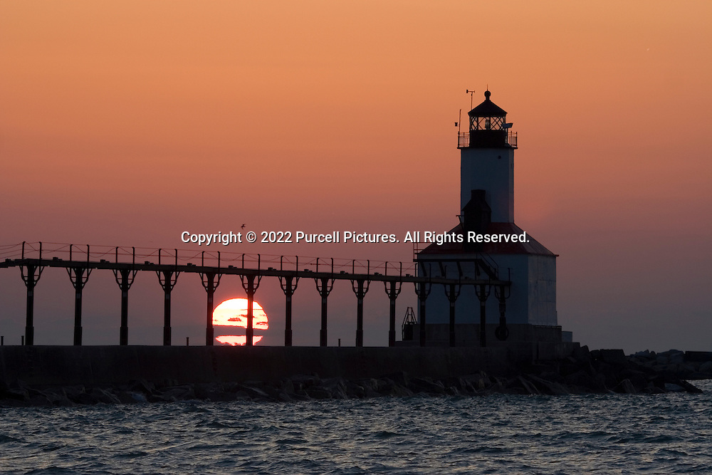 The lighthouse and catwalk in Michigan City Indiana at sunset