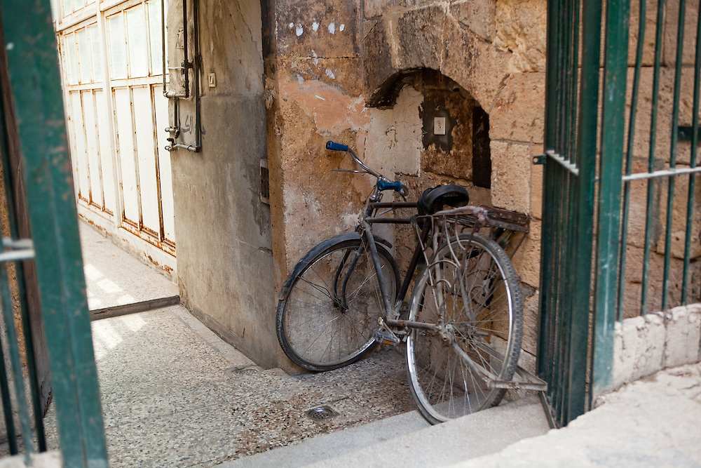 A bicycle nestled in a doorway of an old Aleppo home, Syria