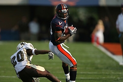 Virginia wide receiver Kevin Ogletree (20) makes a reception while being defended by Wyoming cornerback Julius Stinson (20).  The Virginia Cavaliers defeated the Wyoming Broncos 13-12 in overtime on September 9, 2006 at Scott Stadium in Charlottesville, VA.
